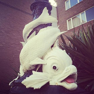 Looks like this fish loves a bit of pole dancing. #SluttyFish #Gyarados #Pokemon #Magikarp #fish #london #strretLight  #sclpture