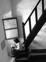 """Where do you read?   {repositioned: 1-23-18} (tvdflickr) Tags: """"streetphotography"""" """"nonposed"""" candid studious individual solitude serenity isolation coolpix nikon buenosaires argentina church window recolleta stairs shadows monochrome tom driggers photobytomdriggers photosbytomdriggers thomasdriggersphotography book reading sitting light student readingroom stairwell"""