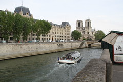 Boating La Seine towards Notre-Dame Cathedral (praja38) Tags: life street city trees people paris france history water stone seine architecture buildings river landscape europe european cityscape cathedral caps humour tourists historic notredame boating capricorn laseine