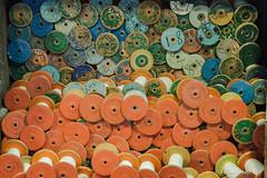Cotton reels at Quarry Bank (Sylviane Moss) Tags: blue orange mill pattern colours nt coton bleu cotton nationaltrust couleur reels quarrybank bobines