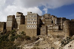 IMG_7911 (mariatarasoff) Tags: yemen sanaa architecture adobe brick ancient old decorative unheritagesite un streets facade mud red white primitive arab arabia arabian countryside landscapes relief brown window arch archway stone traditional sky blue patterns clouds yemeni