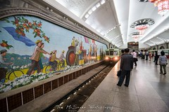 The elaborate Pyongyang Metro stations covered in chandeliers, colourful mosaics and carriages from East Germany (tommcshanephotography) Tags: adventure asia communism dprk democraticpeoplesrepublicofkorea expedition exploring kimilsung kimjungil kimjungun northkorea pyongyang revolution secretcompass travel trekking