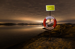 No diving (Per-Karlsson) Tags: night nightphoto nightscape sweden swedishwestcoast bohusln bohuslan overcast lifebuoy nodiving sign sea seascape water waterscape outdoor