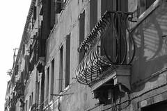 curvilinear railing, ornate, cast shadows, window, architecture, Dorsoduro, Venice, Italy, Nikon D40, nikon nikkor 55mm f-3.5, 10.26.16 (steve aimone) Tags: railing window curvilinear shadows castshadows architecture architecturalforms dorsoduro venice italy nikond40 nikonnikkor55mmf35 nikonprime primelens blackandwhite monochrome monochromatic