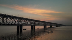 Bridge (mharish441) Tags: bridge sun set sunset morning water river reflections boats shadow sky orange light infinity
