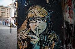 streetart quiet girl in naples (Sascha Behr) Tags: streetart naples neaple napoli italien italia italy arte art kunst graffiti graffito glasses girl calmo quiet doorcase trrahmen