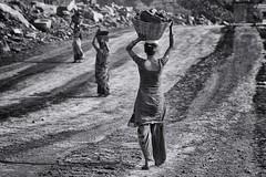 women miners (daniele romagnoli - Tanks for 15 million views) Tags: coalmines coal dhanbad jharia jharkhand miners minatori donne women    indien india romagnolidaniele d810 nikon asia  inde indiane indiani  strada street road bianconero biancoenero bw indie blackandwhite monocromo monochrome kolkata donna woman miniera carbone