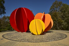 Porta 2007 (phunnyfotos) Tags: phunnyfotos australia victoria vic northeastvictoria wodonga 2007 art sculpture artinstallation publicart colour color gate entrance exit circle sphere spheres red orange yellow kenraff nikon d750 nikond750 artwork porta2007 theflickrloungeweeklytheme