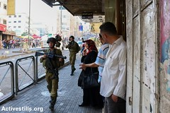 Clashes following the Funeral of Hadeel al-Hashlamon, Hebron, West Bank, 23.9.2015 (activestills) Tags: palestine westbank funeral soldiers weapons hebron israeliarmy topimages mohannaddarabee