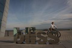 BCN Bliss (Lou Rouge) Tags: barcelona reflection bike skyscape outdoors cycling strada cityscape w bcn streetphotography bicicleta reflejo streetphoto bliss hotelvela