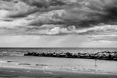 Black clouds and silver linings (Mario Ottaviani Photography) Tags: sony sonyalpha sea seascape italy italia paesaggio landscape travel adventure nature scenic exploration view vista breathtaking tranquil tranquility serene serenity calm black cloud silver linings blackwhite blackandwhite bianco nero biancoenero mare stormyweather storm