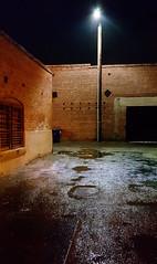 IN THE LIGHT OF DARKNESS (akahawkeyefan) Tags: alley streetlight wet damp asphalt paving brick window davemeyer night