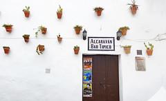 Bar in Arcos de la Frontera (Randy Durrum) Tags: bar arcos de la frontera white villages pueblos blancos alcaravan tipico stucco posters clay pots ceramic