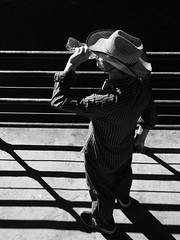 A Drink of Water (Feldore) Tags: santa monica pier water man drinking above birds eye viewpoint abstract candid hat straw feldore mchugh em1 olympus 1240mm shadows railing