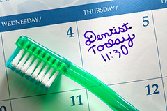 Dental Appointment (Brian Dental Care - Laguna Hills) Tags: macro green horizontal closeup handwriting tooth photography calendar nobody dental brush note oral studioshot toothbrush reminder dentist healthcare hygiene topview appointment oralhygiene dentalhygiene dentalcheckup directlyabove
