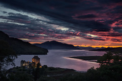 Sunset Over Dornie (Grant Morris) Tags: trees sunset castle water canon scotland waterfront redsky eileandonan darkclouds waterscape 24105 darkskies dornie eileandonancastle sunsetoverwater abigfave grantmorris grantmorrisphotography