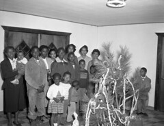 Group gathered around the Christmas tree in Tallahassee (State Library and Archives of Florida) Tags: decorations holidays florida christmastrees groupportraits africanamericanchildren