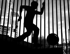 School fence (Draopsnai) Tags: blackandwhite bw monochrome silhouette football child fencing grayscale shard railings southwark