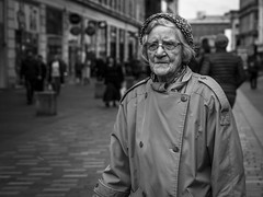 A Penny For Those Thoughts (Leanne Boulton) Tags: people monochrome outdoor urban street candid portrait portraiture streetphotography candidstreetphotography streetlife candidportrait old age elderly woman female face facial expression look emotion feeling beautiful character hat glasses experience tone texture detail depthoffield bokeh natural light shade shadow city scene human life living humanity society culture canon 7d 50mm black white blackwhite bw mono blackandwhite glasgow scotland uk