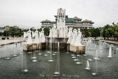 Fountains by the Grand People's Study House in Pyongyang, North Korea (DPRK) (tommcshanephotography) Tags: adventure asia communism dprk democraticpeoplesrepublicofkorea expedition exploring kimilsung kimjungil kimjungun northkorea pyongyang revolution secretcompass travel trekking