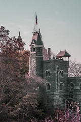 "Color of Autumn 2016 In NYC (View of Belvedere Castle With People Enjoying View of Central Park) (nrhodesphotos(the_eye_of_the_moment)) Tags: dsc0846072 ""theeyeofthemoment21gmailcom"" ""wwwflickrcomphotostheeyeofthemoment"" colorofautumn2016innyc autumn season manhattan nyc centralpark belvederecastle outdoor plantlife foliage people vista perspective flag turtlepond windows stone stonecastle historic landscape rooftop metal clock"