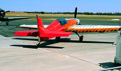 27 Nov 2005 - Stunning paint scheme on Tom Moon's Extra 300S aerobatic plane at the Aviation Museum airshow, Temora, NSW, Australia (aussiejeff) Tags: new museum wales plane airplane flying paint aircraft aviation south airshow nsw stunning scheme extra stunt aerobatic 300s temora tommoon