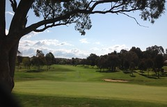 Looking across the green into the afternoon light. (spelio) Tags: australia 2015 email travel act ipad actcanberrasept2015walkstrollwanderscenic ngunnawal walk 2913 australiancapitalterritory lakesgolf moment