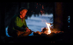 edited-34 (www.AlastairHumphreys.com) Tags: canada ontario explorecanada algonquin camping fire campfire night dark flames man person solo solitary alone blue reflection