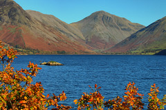 Wastwater (Andy Watson1) Tags: wastwater great gable greatgable yewbarrow scafell pike range western lake district national park cumbria autumn autumnal island fall mountains water blue sky leaves colour orange yellow red november england english uk united kingdom britain british travel trip landscape view scenery scenic countryside hill slope slopes wasdale head shadow light rocks hike hiking walking nature canon 70d