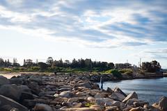 (saddamqureshi) Tags: rocks beach fishing people streetphotography sky nature fujifilm 35mm water