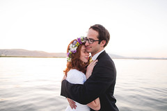embrace (KieraJo) Tags: wide angle canonef24mmf14liiusm l lens canon 5d mark 3 iii 5d3 fullframe dslr bridals bridal portrait flower crown sunset backlit red hair redhead beautiful pretty clean simple background flowers water cute couple love groom wedding formals suspenders glasses dark embrace embracing hugging cuddle pose
