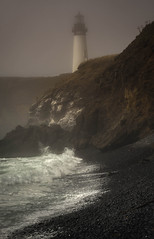 Yaquina Head Lighthouse - Newport, Oregon (www.rootsstudiophoto.com) Tags: lighhouse lighthouse yaquinahead oregon coast pacificocean ocean oregoncoast coastal beach storm pacificcoast pacificstorm northwest pacificnorthwest scenery cliffs waves fog