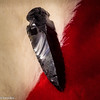 Macro Mondays: Arrow (brookis-photography) Tags: arrow arrowhead black red white glass volcanic fur hard soft macromondays