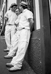 "Something funny (""NightOwl"") Tags: street friends blackandwhite white man portugal monochrome smile fun blackwhite pub friend uniform friendship candid joke sony streetphotography laugh local monte fe cheerful joking madeira a7 toboggan oss portugese carreiros 2870mm f3556 havingabreak conversiation sonya7fe2870mmf3556oss"