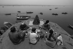 Meditation in chaos (Ravikanth K) Tags: travel people blackandwhite india water monochrome festival boats dawn worship chaos dev varanasi meditation devotees kashi ganga deepawali ganges pradesh ghats banaras karthika uttar pournami kasi dewali 500px karthiga