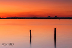 Bribie Island Sunset (Beth Wode Photography) Tags: sunset dusk bribieisland posts pumicestonepassage glasshousemountains smoke smokysunset orangesky beth wode bethwode