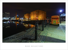 Warm reflections (Parallax Corporation) Tags: albertdock liverpool nightime maritimemuseum reflections spotlights wideangle orange van longexposure architecture