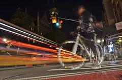 lights streaking by a ghostly bike rider in new york city (norlandcruz74) Tags: gorillapod 6thavenue newyork newyorkcity nyc ny manhattan streaking streak lights trails light longexposure night dx d5100 nikon filam filipino pinoy norlandcruz