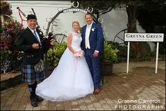 Pipers at Gretna Green (graeme cameron photography) Tags: gretna green independent wedding photographers famous blacksmiths piper bagpipes bride groom fun smiling