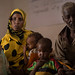 Halima Abdi Awbashir, 25 feeding supplementary food her malnourished two children, Shiki Osman 2 and Muktar Osman 3.