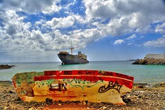 Wrecked Rower (tcees) Tags: lascaletas lanzarote beach shipwreck templehall telamon rowingboat sky clouds rocks ship