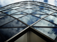 Fractured Sky (Douguerreotype) Tags: uk gb britain british england london architecture stmaryaxe gherkin reflection window buildings city urban sky clouds geometric lines