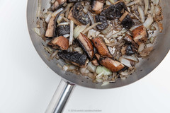 Pan with baked pieces of portobello mushrooms, sliced onions, olive oil, clove garlic, dried coriander, tobasco, Worcestershire sauce, black pepper and salt. (annick vanderschelden) Tags: worcestershiresauce bakedpieces blackpepper clovegarlic cooking culinary driedcoriander food greek mushrooms oliveoil pan portobello recipe salt slicedonions tobasco