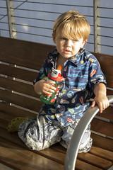Waiting for the train (quinn.anya) Tags: sam preschooler waterbottle bench waiting train