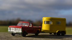 In the Old Corral (mitchell_dawn) Tags: matchboxcars pickup ford ponytrailer horsebox red yellow towing 60s 1960s sixties classic toycar toys vintage