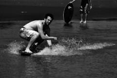DSC_0039 (Travis Schuldt) Tags: sea blackandwhite beach water monochrome sport washington seaside movement sand outdoor pacificnorthwest bellingham pnw skimboarding bnw skimboard skimming