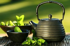 Black asian teapot with mint tea (blog.arikurniawan) Tags: china wood brown india canada black hot green cup japan asian japanese gold leaf healthy asia iron rice tea sweet indian traditional chinese culture mint lifestyle dry bowl east mat drinks zen crop medicine healthcare herb variation saucer loose zenlike brewed asiaasianbowlbrewedbrownchinachinesecropculturecupdrinksdryeastgreenhealthcarehealthyherbhotindiaindianjapanjapaneseleaflifestyleloosematmedicinericemintsaucersweetteatraditionalvariation