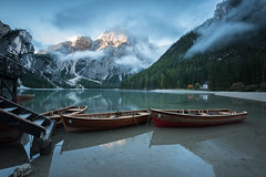 Pearl of the Dolomites (helena678) Tags: lake peaceful serene water green mountains boats rowingboats clouds mist sun peaks sunrise morning autumn fall reflections pragserwildsee lagodibraies seekofel southtyrol dolomites italy iful