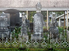 Grimy Graves (mikecogh) Tags: apia samoa graves grime cemetery statues fleurdelis