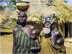 Mursi Tribe Women and Children (Luc V. de Zeeuw) Tags: child children clay corn ethiopia lipplates mun mursi omo omovalley plate tribe woman wood southernnationsnationalitiesandpeoplesregion
